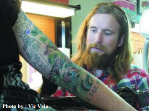 Willie Stewart touches up a tattoo inside his Ananda Art